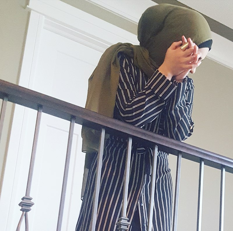 Olive green with a black and white striped shirt